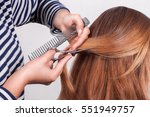 hairdresser cuts  brown haired... | Shutterstock . vector #551949757