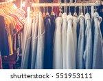 sweaters hanging on metal...   Shutterstock . vector #551953111