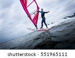 freestyle windsurfer doing... | Shutterstock . vector #551965111