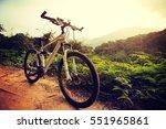 riding mountain bike on... | Shutterstock . vector #551965861