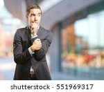 frightened young businessman | Shutterstock . vector #551969317
