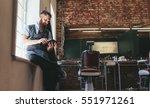 hairstylist using digital... | Shutterstock . vector #551971261
