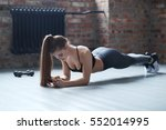workout  sport. woman in the gym | Shutterstock . vector #552014995
