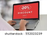 woman using a laptop with... | Shutterstock . vector #552023239