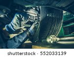 car mechanic fixing tie rod and ... | Shutterstock . vector #552033139