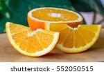orange fruit on wooden table... | Shutterstock . vector #552050515