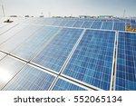 solar panels against blue sky | Shutterstock . vector #552065134