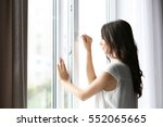 beautiful woman opening window... | Shutterstock . vector #552065665