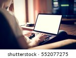 man using  working on laptop... | Shutterstock . vector #552077275