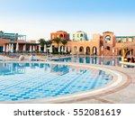 sun over hotel pool  | Shutterstock . vector #552081619