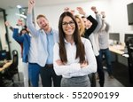 Small photo of Happy business people celebrating success at company