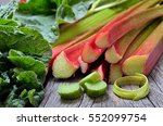Rhubarb On Wooden Table