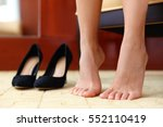 high heels shoes and feet... | Shutterstock . vector #552110419