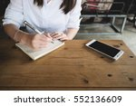 young woman writing in the... | Shutterstock . vector #552136609