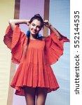 happy woman spinning in orange... | Shutterstock . vector #552144535