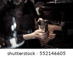 barista steams milk for a coffe ... | Shutterstock . vector #552146605