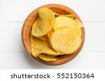 chips in a wooden bowl | Shutterstock . vector #552150364