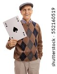 Small photo of Happy elderly man holding a big ace of spades card isolated on white background