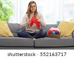 confused young woman sitting on ... | Shutterstock . vector #552163717