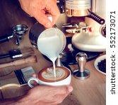 coffee latte art make by...   Shutterstock . vector #552173071