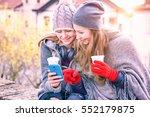 young women looking phone... | Shutterstock . vector #552179875