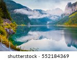 misty summer morning on the... | Shutterstock . vector #552184369