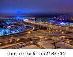 Saint-Petersburg, Russia - December 29, 2016: Top view of the city at night, road transport interchange of the expressway and the football stadium. - stock photo