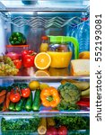 open refrigerator filled with... | Shutterstock . vector #552193081