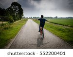 young boy is riding bicycle in... | Shutterstock . vector #552200401