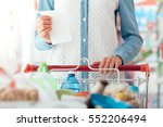 woman doing grocery shopping at ... | Shutterstock . vector #552206494