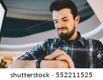 serious man looking at his... | Shutterstock . vector #552211525