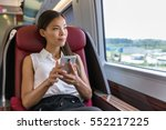 asian woman relaxing in train... | Shutterstock . vector #552217225