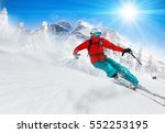 Skier Skiing Downhill During...