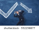 businessman cowering on blue... | Shutterstock . vector #552258877