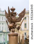 Small photo of Two headed eagle coat of the arms of Russian empire on fence of Alexander column, Saint Petersburg, Russia