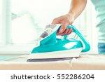 closeup of woman ironing... | Shutterstock . vector #552286204