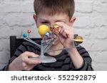 close up cute little boy is...   Shutterstock . vector #552292879