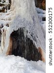 winter icy waterfall close up | Shutterstock . vector #552300175