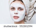 cream on her face  mask  skin  ... | Shutterstock . vector #552301594