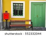 red post office box and bench... | Shutterstock . vector #552332044