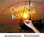 Small photo of Woman Hand Writing Challenge Accepted with a marker over transparent board. Isolated on Sunset Boat. Business concept. Stock Photo