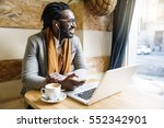 businessman using his laptop in ... | Shutterstock . vector #552342901