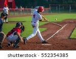 baseball batter hits the ball | Shutterstock . vector #552354385