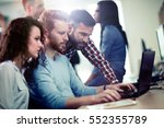programmers cooperating at  it...   Shutterstock . vector #552355789