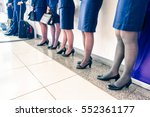 row of stewardess and pilot at... | Shutterstock . vector #552361177