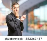 surprised businessman pointing | Shutterstock . vector #552363457