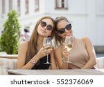 portrait of two young brunettes ... | Shutterstock . vector #552376069