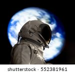 astronaut and earth reflections | Shutterstock . vector #552381961