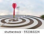 red dart arrow hit in the... | Shutterstock . vector #552383224