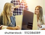 team of young male and female... | Shutterstock . vector #552386089